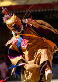 The dancer in mask performing religious Cham dance in Ladakh, In stock photo