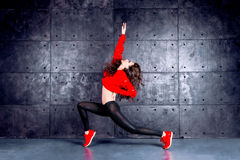 Dancer in motion. Girl dancing in front of the urban wall Stock Photos