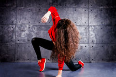 Dancer in motion. Girl dancing in front of the urban wall Royalty Free Stock Photo