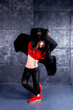 Dancer in motion. Girl dancing in front of the urban wall Royalty Free Stock Images