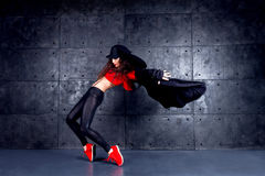 Dancer in motion. Girl dancing in front of the urban wall Royalty Free Stock Image