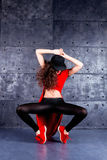 Dancer in motion. Girl dancing in front of the urban wall Stock Image