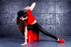 Dancer in motion. Girl dancing in front of the urban wall Royalty Free Stock Photos