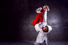 Dancer in motion. Guy break dancing isolated on black background. Urban style Royalty Free Stock Photos
