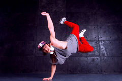 Dancer in motion. Guy break dancing isolated on black background. Urban style Royalty Free Stock Photo