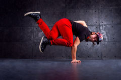Dancer in motion. Guy break dancing isolated on black background. Urban style Stock Image