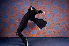 Dancer in motion. Young dancer standing on his tiptoes. Urban style Stock Photos