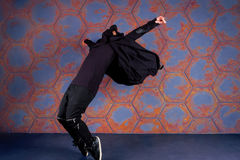 Dancer in motion. Young dancer standing on his tiptoes. Urban style Stock Photo