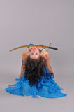 Dancer. Oriental dance with saber Royalty Free Stock Image