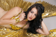 Dancer. Oriental dancer dances in costume Stock Photography