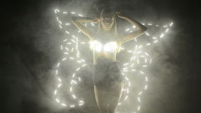 Dancer performing in led costume with butterfly wings stock footage