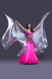 Dancer performing oriental dance with wings Royalty Free Stock Photos