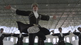 Dancer performs turns around ingushetia folk ensemble stock footage