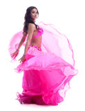 Dancer in pink costume performing oriental dance Stock Photography