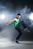 Dancer posing on background with flashes and smoke Royalty Free Stock Photography