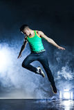 Dancer posing on background with flashes and smoke Royalty Free Stock Images