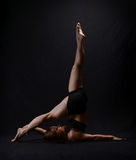 Dancer Posing. Beautiful female dancer stretching and posing during workout Royalty Free Stock Photos
