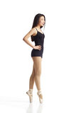 Dancer Posing en Pointe. Full body portrait of asian american dancer posing en Pointe in studio on white background wearing classic ballet clothing (black Stock Photos