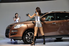 Dancer posing near car at Chengdu Motor Show 2012 Royalty Free Stock Images