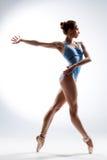 The dancer. Dancer posing on a studio background Stock Photos