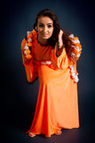 Dancer posing in traditional orange costume Stock Images