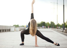 Dancer practices outdoors Royalty Free Stock Photo