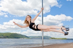 Dancer on pylon background of blue sky and river Stock Image
