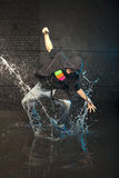 Dancer in rain. Hip hop dancer splashing water while dancing in the rain stock photos