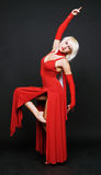 Dancer in red evening gown Stock Photography