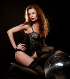 Dancer redhair girl with disco ball stock photography