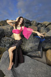 Dancer on the rocks Stock Image
