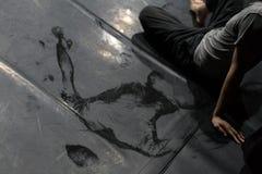 Dancer`s back on floor. Scenic imprint of the dancer`s back on a dark dance floor royalty free stock photo