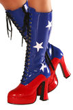 Dancer's Boots. Woman's legs in red white and blue boots. Copy space. Isolated stock photo