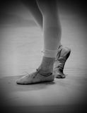 Dancer's feet with old shoes and bandage Stock Photo