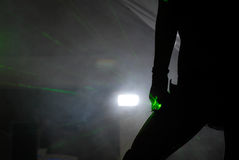 Dancer\'s Silhouette. Silhouette of dancer with green beams Royalty Free Stock Photos