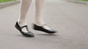 Dancer`s legs. Girl dancing solo jazz swing dance on the city`s square pavement. Charleston dance. close-up stock video