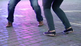 Dancer's legs perform lindy hop dance step on the city's square pavement. Street music day. Dancer's legs perform lindy hop dance step on the city square stock video