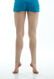 Dancer's Muscular Legs with Blue Shorts Royalty Free Stock Image