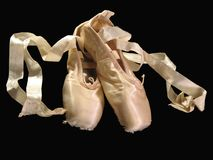 A Dancer's Tools. A pair of pointe shoes isolated on black Stock Image