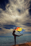 Dancer at the sea during sunset Royalty Free Stock Image