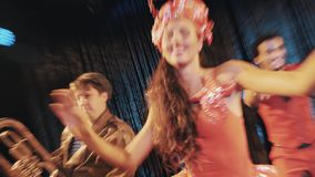 Dancer in sea themed red shrimp carnival costume perform with funny troupe. Dancer in sea themed red shrimp carnival costumes performing on scene with funny stock video