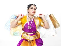 Dancer with shopping bags Stock Image