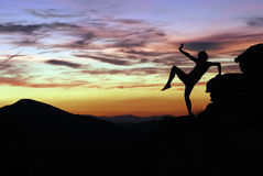 Dancer silhouette at sunset in Joshua Tree Royalty Free Stock Photography
