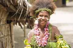 Solomon Islands, beautiful woman dressed with flowers and leaves. Nemba, Utupua, small island in South Pacific Ocean