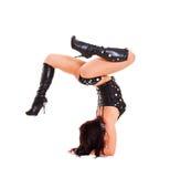 Dancer standing on her hands Stock Images