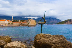 Dancer statue and Old Town in Budva Montenegro Royalty Free Stock Photo