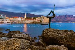 Dancer statue and Old Town in Budva Montenegro. Architecture travel background Royalty Free Stock Images