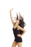 Dancer Striking fun Pose. Half body portrait of asian american dancer posing in studio on white background wearing classic ballet clothing (black leotard and stock photography