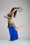 A dancer with a tambourine royalty free stock photography