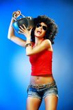 Dancer with tape recorder. Happy tanned woman with afro haircut enjoying music holding tape recorder Royalty Free Stock Photography